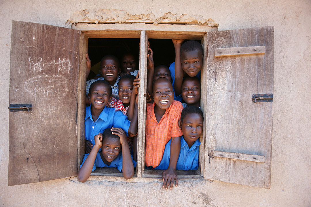 African children look out from window