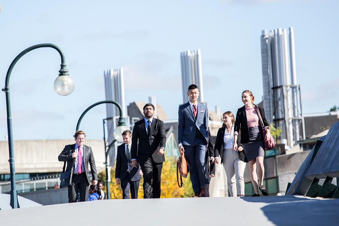 Business Administration students walking across Faryon Bridge