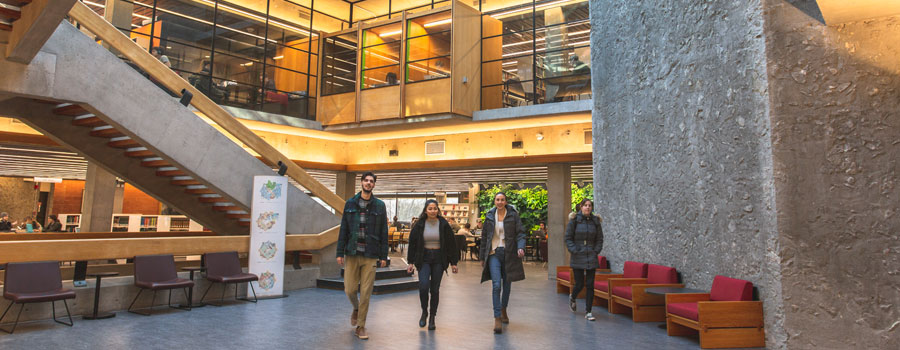Students walking in Bata Library