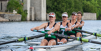4 Women rowing in a scull across the Otonabee river in the early morning