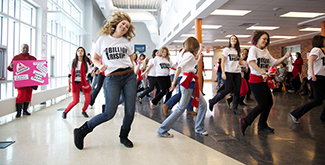 Student group dancing in the foyer of the Oshawa campus