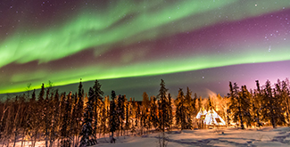 Aurora Borealis over Teepees in Yellowknife in the witner time