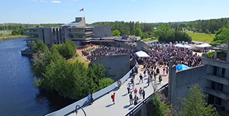 Trent Aerial view of people walking across the Faryon bridge