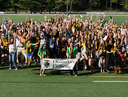 Group of Otonabee College students with college banner