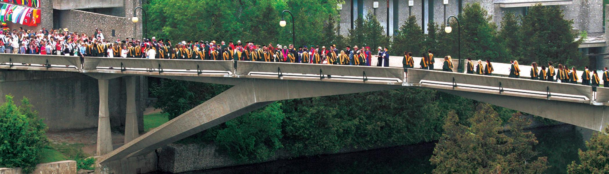 Students walking across Faryon Bridge
