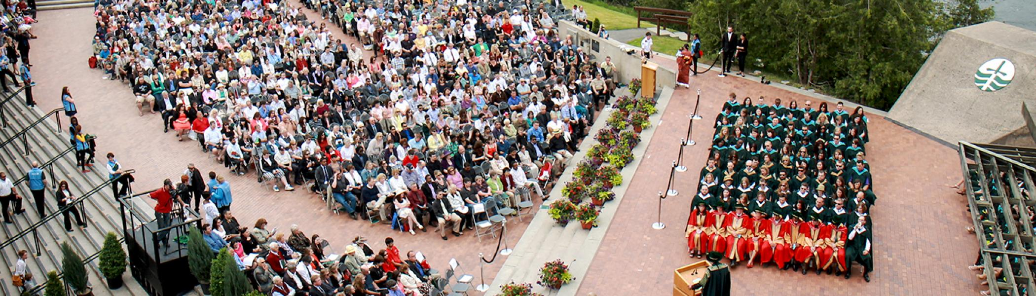 Arial photo of the podium at Bata library during convocation. The seats are all full.