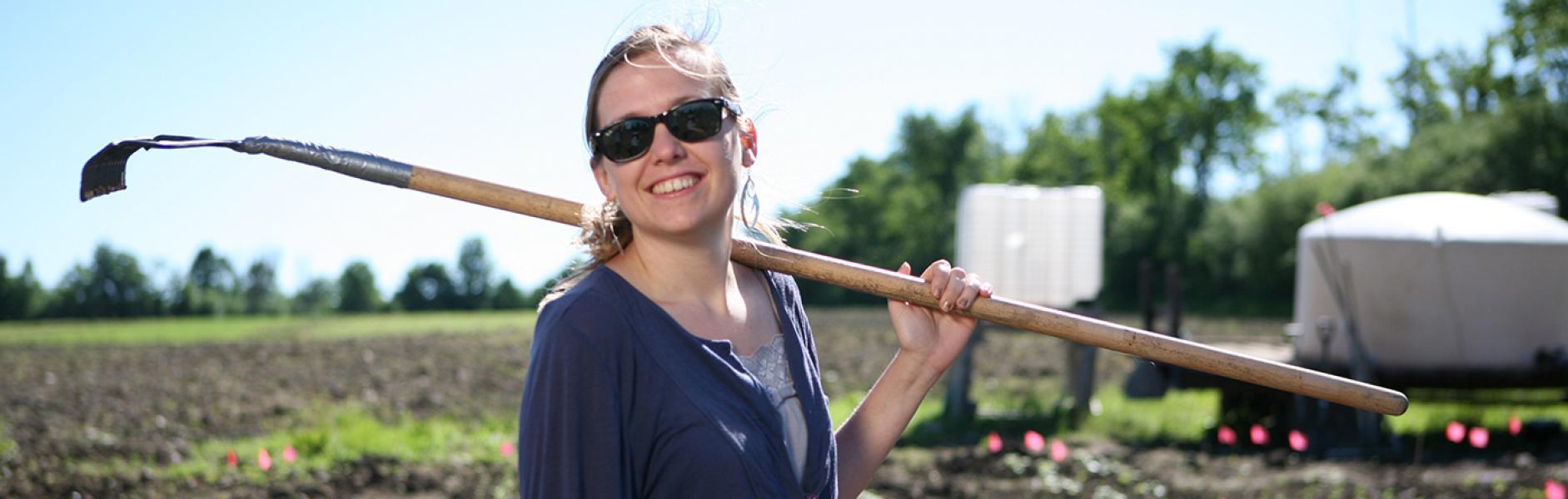 Girl holding a garden hoe in the Trent market garden