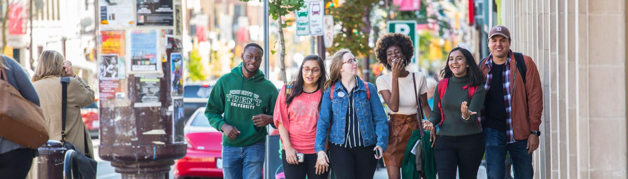 A group of six students walking downtown.