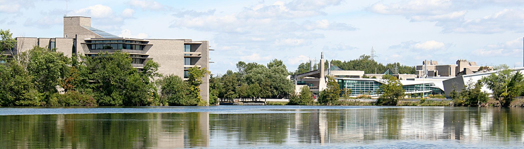 A summer spring time vista looking at the Bata library and the Science Complex from the river.