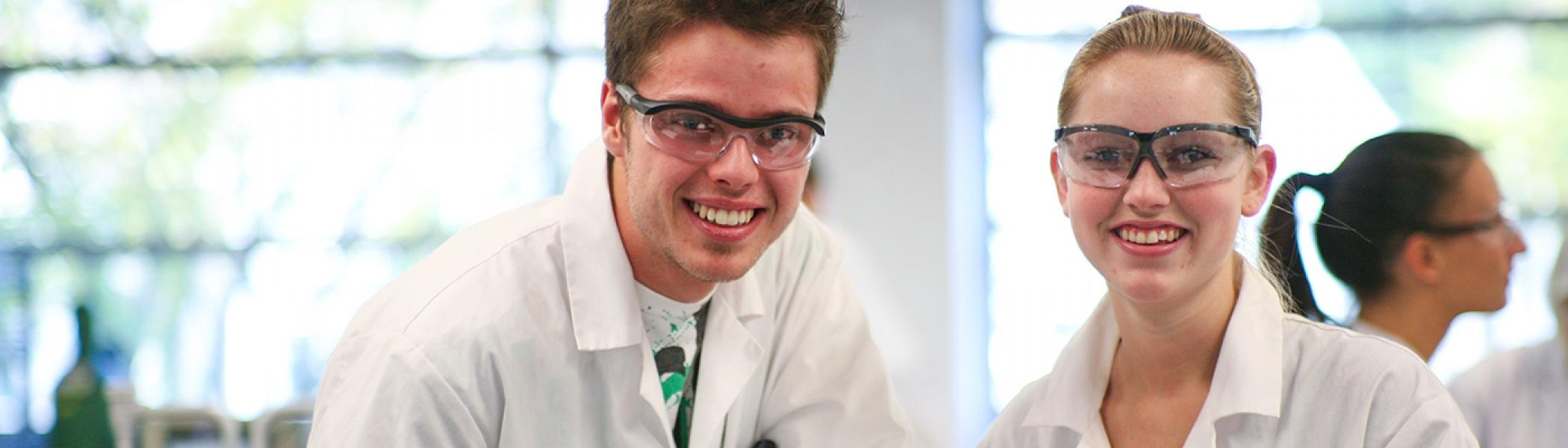 Two students working in a lab.