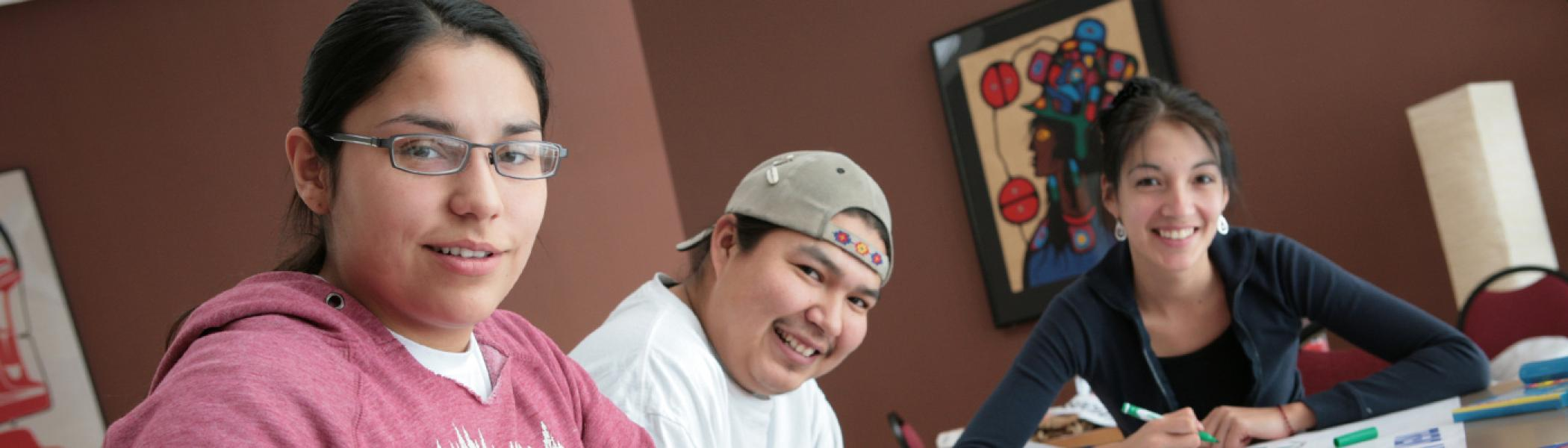 Indigenous students sitting at a project table in Gzowski College