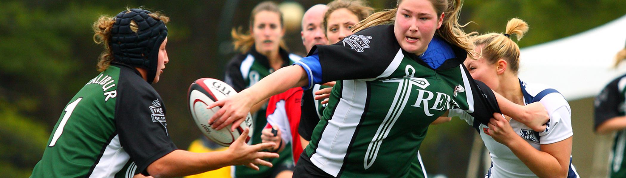 Women's outdoor rugby game in the fall at the Justin Chiu stadium