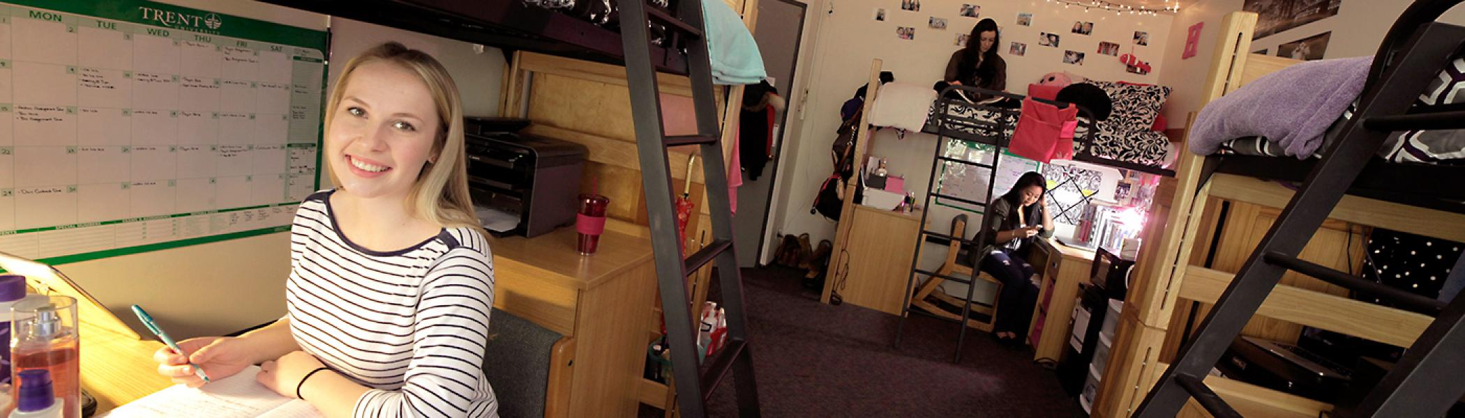 Student studying in her Otonabee college dorm room