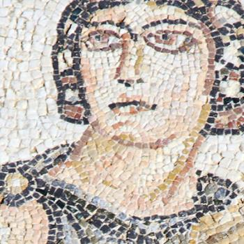 Ancient greek mosaic of person holding a vase