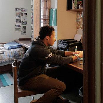 Student studying in Trent University dorm room