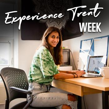 Experience Trent Week, student in residence room working on laptop.