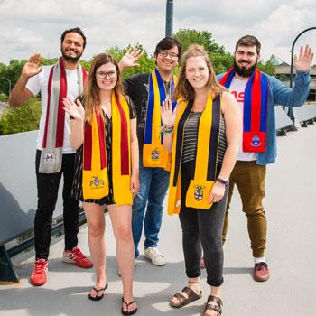 Student representatives from the colleges gathered for a photo wearing their scarves.