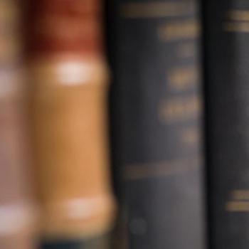 Bookshelf with legal textbooks
