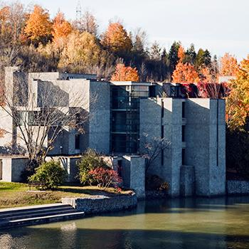 Exterior view of Champlain College in the fall around mid-day