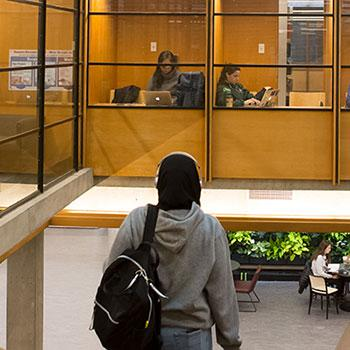 Student walking down stairs in newly renovated Bata Library