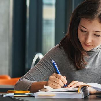 a student working on her assignment in the library