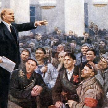 A dramatic painting of Lenin speaking to soldiers and workers in Smolny's Grand Hall.