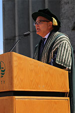 Don Tapscott on stage in Regalia during convocation.