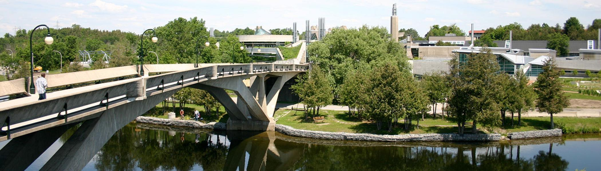 Faryon bridge and the buildings on the east bank of Trent University on a sunny day