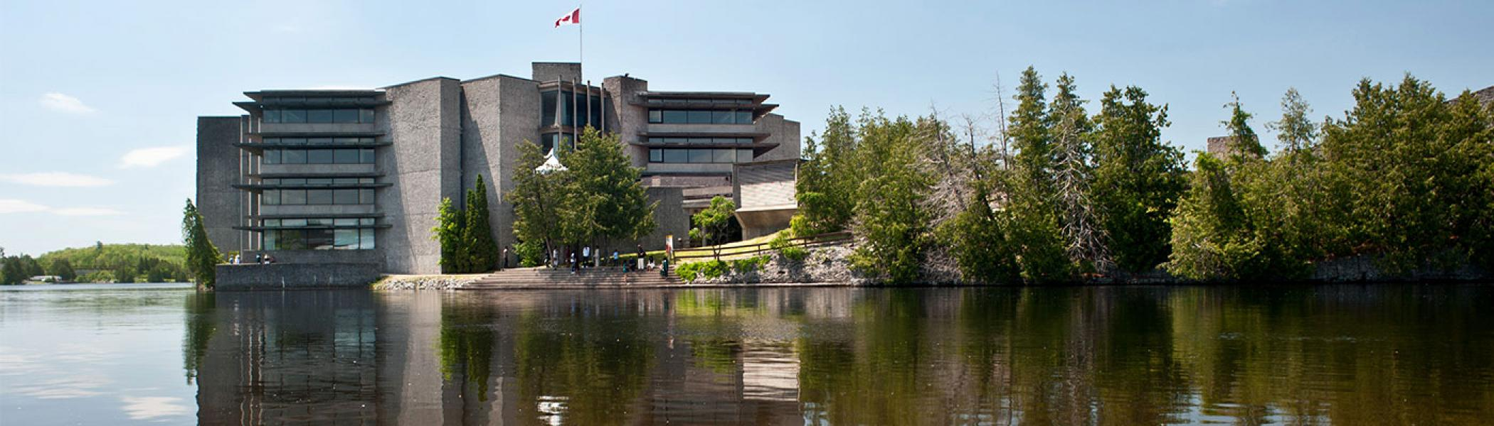 Trent's Bata Library from across the Otonabee river on a cloudless, summer day