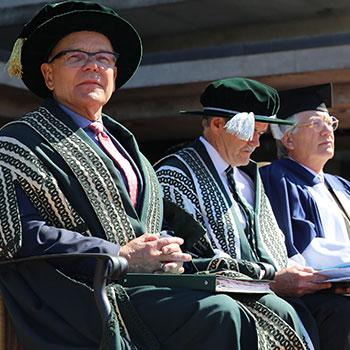 Chancellor Don Tapscott wearing full regalia and looking off into the distance during convocation.