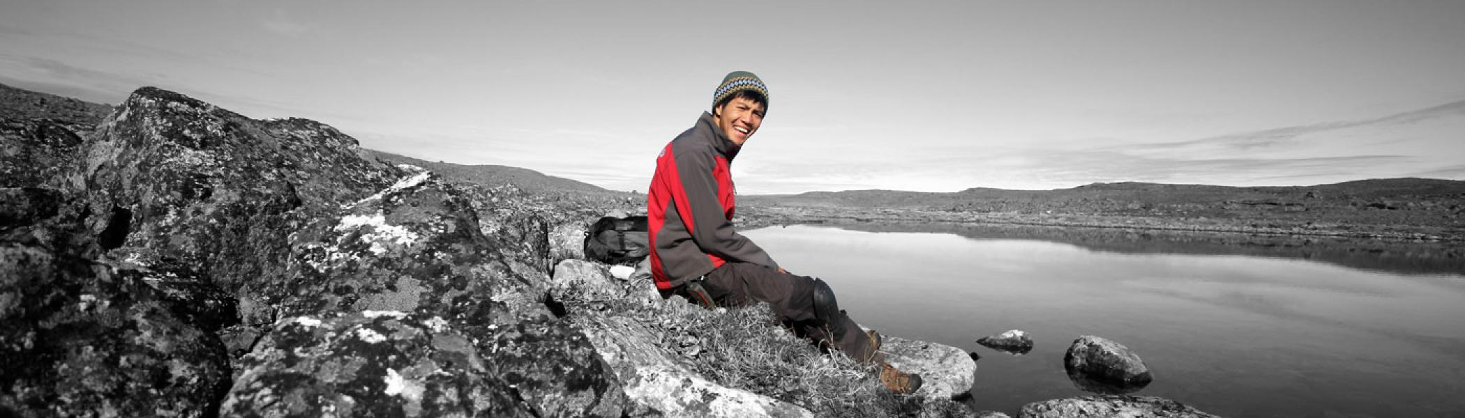 Environmental and Life sciences student sitting on a cliff
