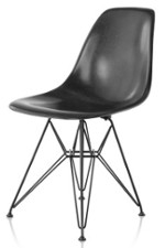 Black fiberglass chair with a very high base holding a one piece seat with no arm rests