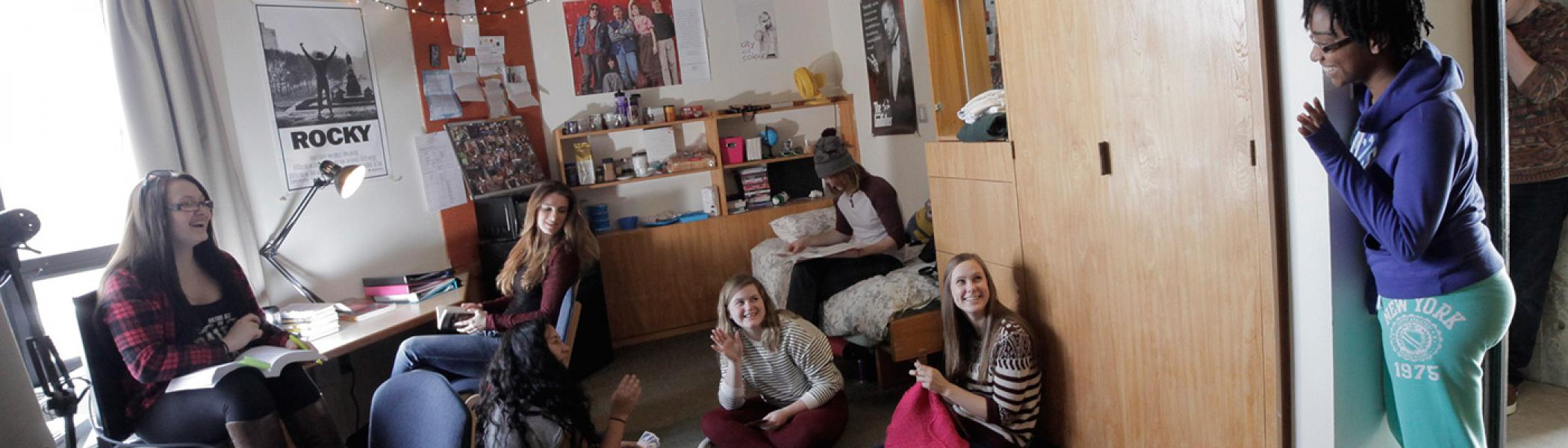 Group of students in a Lady Eaton College residence room