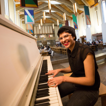 Student playing the piano in the Champlain College Great Hall