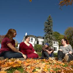 students sitting in front of the Traill College