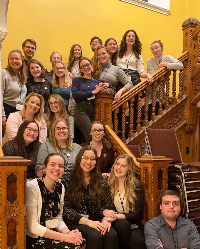 Student members from the conference sitting on the stairs of the venue where the conference was held