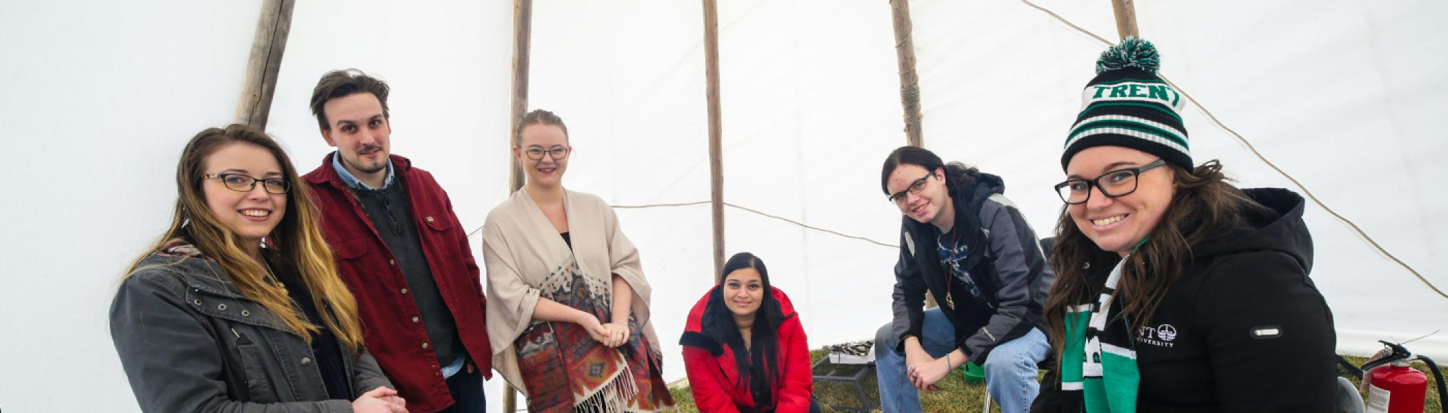 Students gathered in tipi