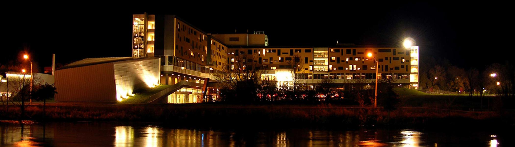 Gowski College in the moonlight from across the Otonabee river