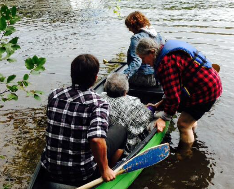 Elder Shirley Williams with students in Canoe