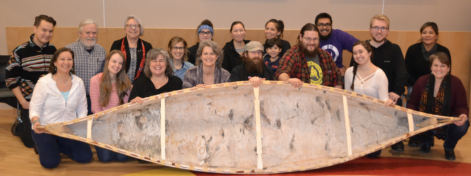 group shot with canoe
