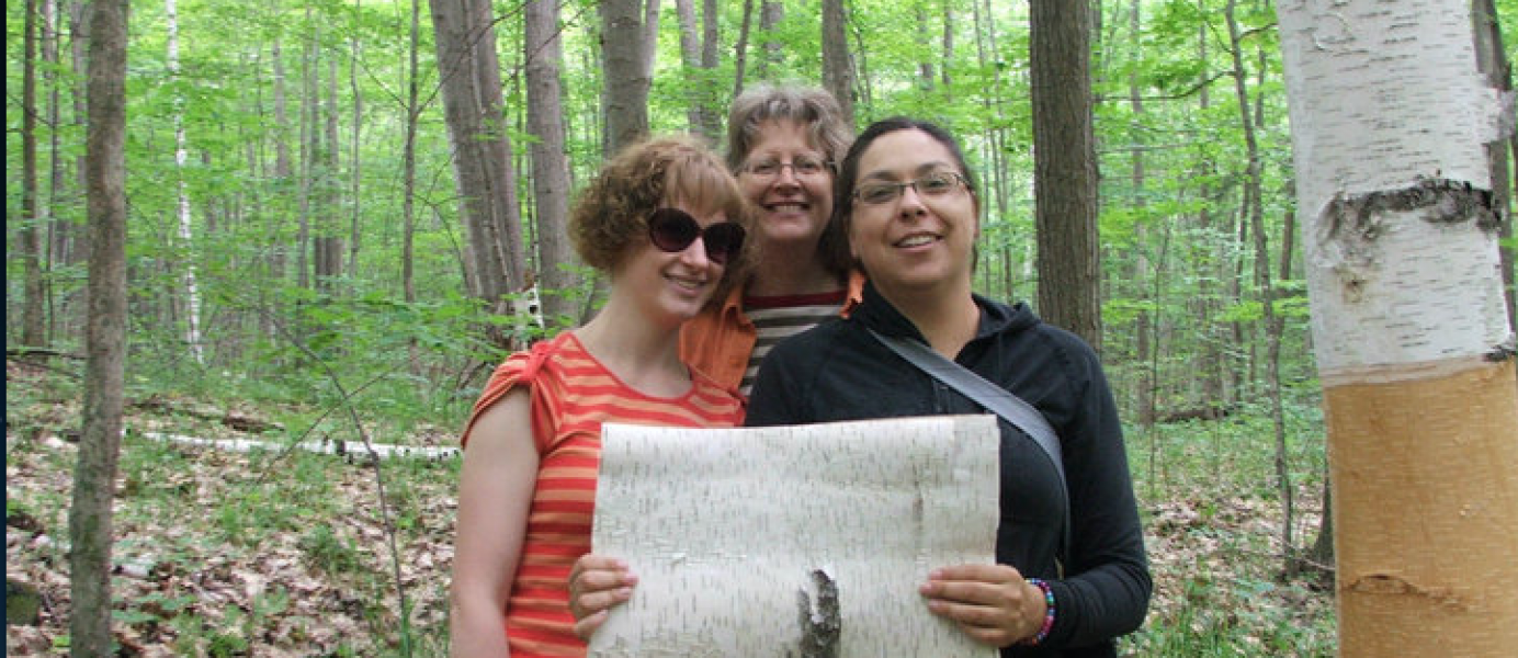 PhD Students peeling birchbark