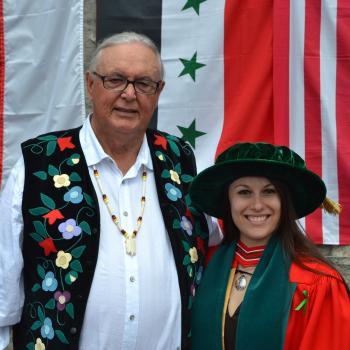 Elder Doug Williams with PhD graduate