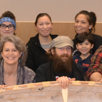 A group of Students in the Bata Library with a Birchbark Canoe they made
