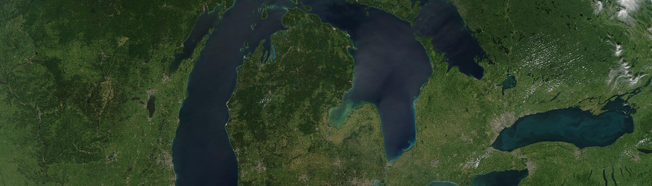 Aerial picture of the great lakes and surrounding forest