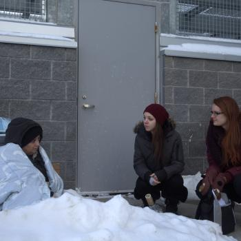 Two nursing students and one patient actor in a street health simulation