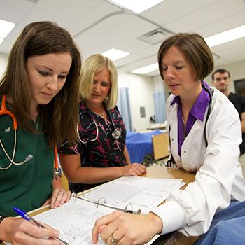 Trent faculty and students in Nursing program in their lab