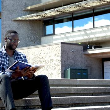 Trent Student studying at Bata Library steps
