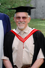Lionel Rubinoff in a black graduation cap and gown