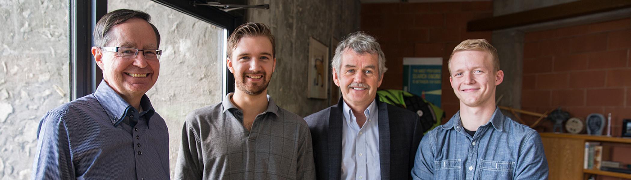 Dr. Leo Groarke, James Middleton, Adam Ryan & Rylan Auger standing side by side, smiling at the camera