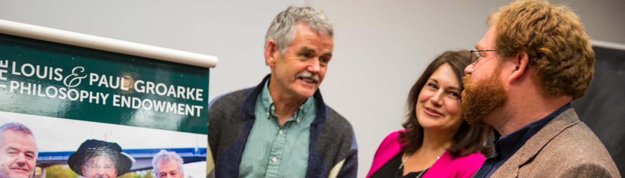 Dr. Leo Groarke with Julie Davis and philosophy professor